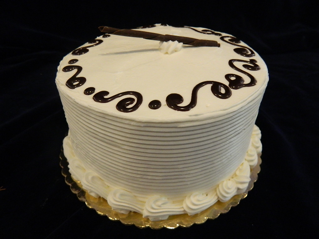 PRESIDENTIAL TORTE CAKE: Alternating layers of chocolate & vanilla cake merged together with a rich chocolate mousse filling, coated in white buttercream, and accentuated with ganache swirls.