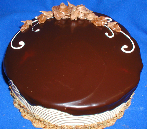 CHOCOLATE ESPRESSO TORTE CAKE: Yellow cake accentuated with splashes of Kahlua, filled with a mocha mousse, mocha buttercream, and topped with chocolate ganache.