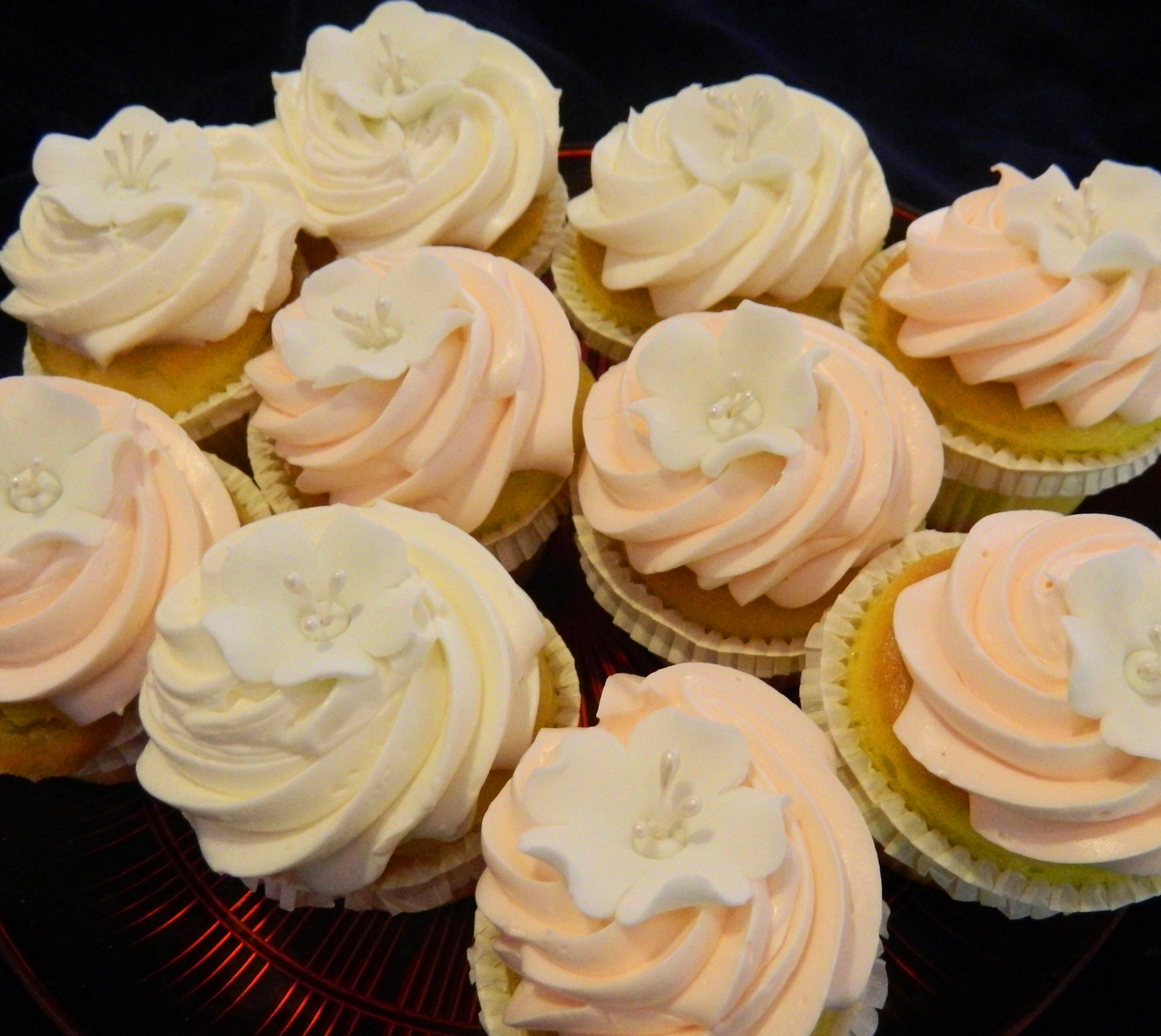 Cupcakes sophisticakes dinkels cupcakes with frosting and flower applique mightylinksfo
