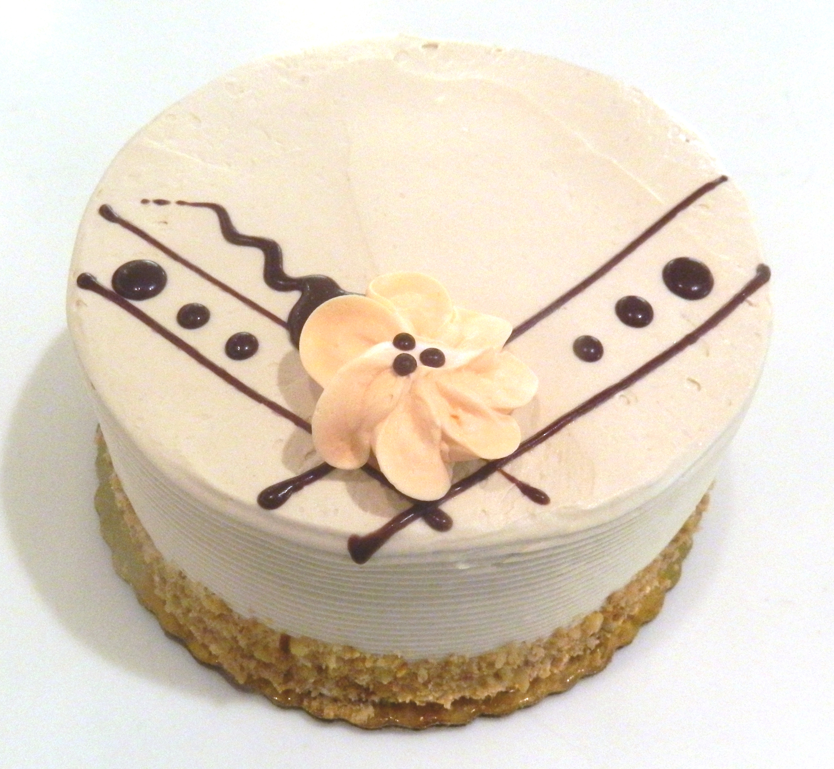 FRANKFORT TORTE CAKE: Delicious yellow cake, filled with hazelnut buttercream & ganache, finished off with a hazelnut buttercream.
